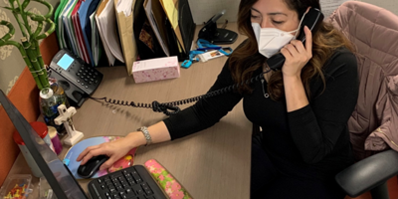 Catholic Charities Case Manager Gloria del Mar Garcia Lemus navigates back-to-back calls from individuals seeking rental assistance at the agency's Mission District office in San Francisco.